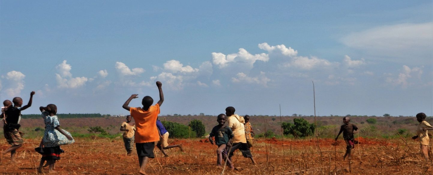 African children flying kites.